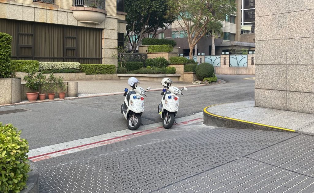 Police scooters checking on a quarantined citizen